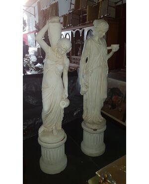 Coppia di sculture in graniglia