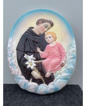 Formella in terraglia policroma con figura di Sant'Antonio da Padova e Gesu'Bambino.Manifattura Ronzan,Torino.