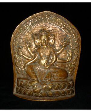 Divinità Vasudhara Nepal rame dorato repoussè